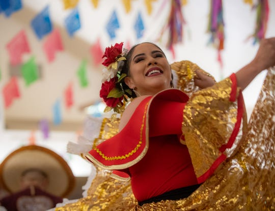 Folklorico dancer swings her golden dress around during the annual veneration of the Virgen de Guadalupe's novena at the St. Mary of the Nativity Church on Dec. 03, 2019.