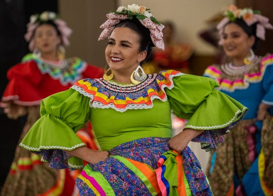 A folklorico dancer smiles as she dances with the rest of her group during the annual veneration of the Virgen de Guadalupe's novena at the St. Mary of the Nativity Church on Dec. 03, 2019.