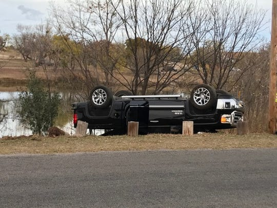 San Angelo police investigate a pickup that flipped on South Concho Park Drive on Wednesday, Dec. 4, 2019.