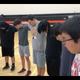 The McLaughlin boys basketball team honors late Dupree freshman before practice.