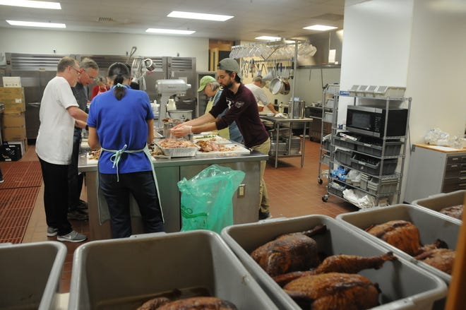 This photo is from last year's food preparation for the annual Christmas Dinner for Those Alone.