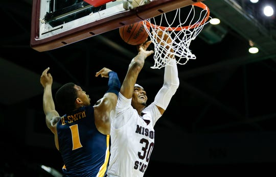 Missouri State Bears senior Tulio Da Silva has a dunk swatted away by Murray State's DaQuan Smith during a game at JQH Arena on Tuesday, Dec. 3, 2019.