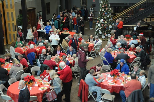 This photo is from the 2018 Christmas Dinner for Those Alone. Organizers of this year's event expect to serve about 750 guests.