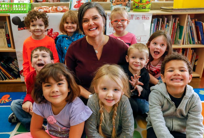 Missy Riley, director of early childhood education in Springfield Public Schools, sits with students from the Campbell Early Childhood Center on Wednesday, Dec. 4, 2019. Riley will retire at the end of this school year.
