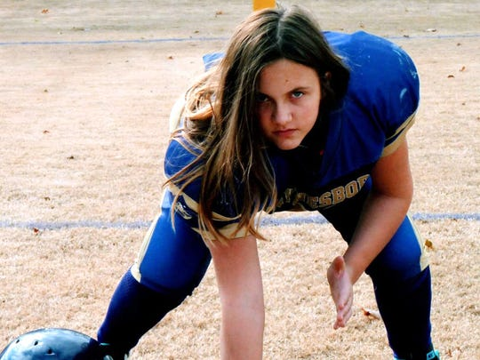 Destiny Keyes, 12, isn't bothered that she's one of the few girls to play in the Augusta County Quarterback Club.