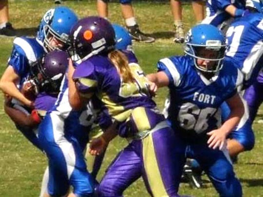 Destiny Keyes plays both the offensive and defensive line for Waynesboro's youth football team.