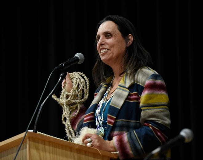 Activist and hemp grower Winona LaDuke holds up the first hemp rope made in Minnesota in an estimated 70 years on Tuesday, Dec. 3, 2019, at the Minnesota Hemp Conference and Expo at the River's Edge Convention Center in St. Cloud.