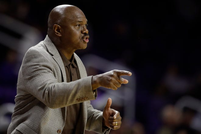Florida A&M head coach Robert McCullum motions to his players during the first half of an NCAA college basketball game against Kansas State, Monday, Dec. 2, 2019, in Manhattan, Kan. (AP Photo/Charlie Riedel)