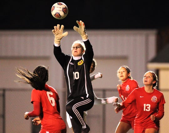 Leon senior keeper Regan Hermeling goes up to grab a corner kick as Lincoln beat Leon 3-0 on Dec. 3, 2019.