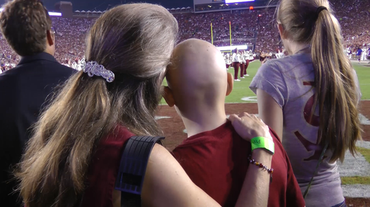Jake and Barbra Crumpacker on the field at FSU-Oklahoma Game in 2011
