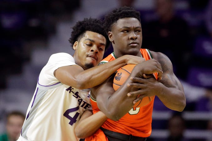 Kansas State's David Sloan, left, tries to steal the ball from Florida A&M's Nasir Core during the first half of an NCAA college basketball game Monday, Dec. 2, 2019, in Manhattan, Kan. (AP Photo/Charlie Riedel)