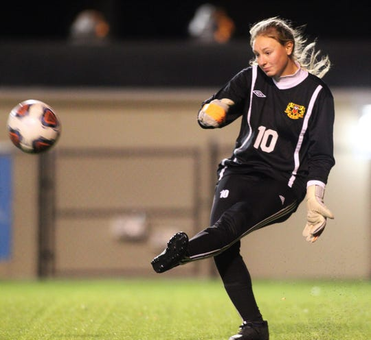 Leon senior keeper Regan Hermeling clears a ball in the box as Lincoln beat Leon 3-0 on Dec. 3, 2019.