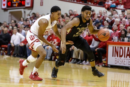 Florida State guard M.J. Walker (23) drives next to Indiana guard Armaan Franklin (2) during the second half of an NCAA college basketball game Tuesday, Dec. 3, 2019, in Bloomington, Ind. (AP Photo/Darron Cummings)