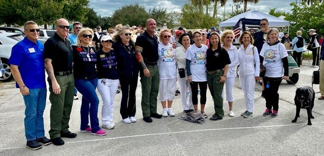 Getting ready to participate in the Nov. 16 Walk-A-Thon for Military Suicide Awareness are, from left, Indian River County Commissioner Joseph Flescher, Deputy Robert Ryan, Gold Star Mother Lisa Heinz; Jo Ann Maitland and Lorrie Fleming; Army veteran and Deputy Michael Dilks; Michelle Dale, president of Indian River County Gold Star Mothers; Laura Clement; Gold Star Wife Wendy Guy; Deputy Michelle Rispoli, Air Force Reserves; and Diana D'Angelo, Roma Anderson and Annette Kirk.