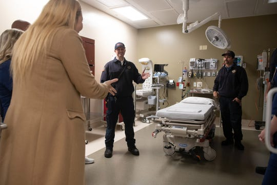"Lawnwood Regional Medical Center's Director of Business Development, Michael-Brianne Presley (from left), talks with Indian River County Fire Rescue Lt. Cliff Beuttell of Fire Station 4, during the soft opening of Lawnwood Regional Medical Center's free-standing emergency department just north of Oslo Road on the east side of U.S. 1 on Tuesday, Dec. 3, 2019, in Indian River County. ""I love it,"" said Beuttell. ""It will be great for the area."""