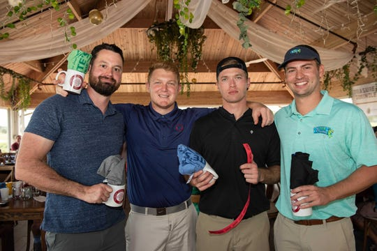 Jim Janowiak, left, John James, Marcus Sigmon and Nick Madden at Fairwinds Golf Club in Fort Pierce for the Treasure Coast Seminole Club Charity Golf Tournament.