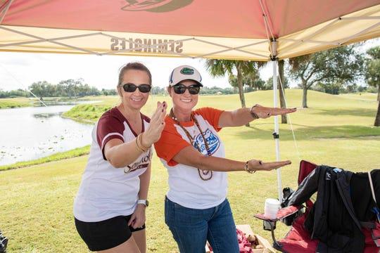 Terri Murphy, left, and Rebecca Moll in a Seminole vs. Gator challenge at Fairwinds Golf Club in Fort Pierce for the Treasure Coast Seminole Club Charity Golf Tournament.