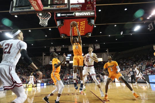 UTEP's Bryson Williams grabs a rebound against New Mexico State Tuesday night at the Pan American Center