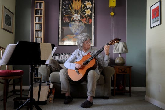 Liz Cole enjoys playing her guitar inside her house at the Golden Oaks mobile home park outside Ojai.