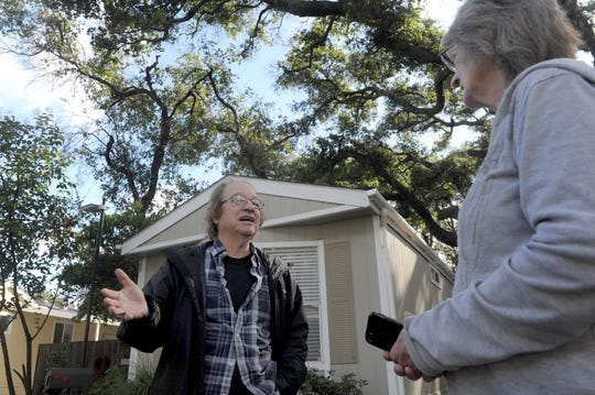 Bill Haff, left, talks with Liz Cole outside his home at Golden Oaks mobile home park outside Ojai. A proposal going to the Board of Supervisors Tuesday would establish special zoning for the 25 mobile home parks in unincorporated Ventura County.