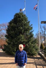 Diane Starn of Vineland stands in front of the tree from her backyard that she donated to the city to become Vineland's official Christmas tree.