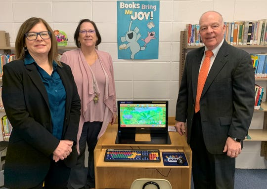 The Cumberland County Bar Association recently made a donation for an AWE Bilingual Literary Station for the Bridgeton Public Library. The gift was in memory of attorney Samuel J. Serata, a former library trustee. Left to right: bar President Deana L. Walsh, library Director Linda McFadden, and bar Trustee Ted Ritter.