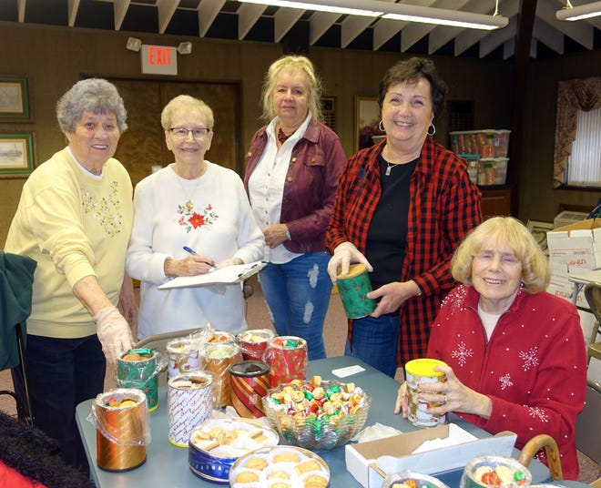 Woman's Club of Vineland members (from left), Phyllis Linton, Joyce Prochaska, Dolores Misiewicz, Diane Ragone and Ann Starkey work on the club's holiday cookie/candy tin project.