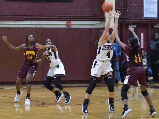 Brooke Weeks applies ball pressure while Adriana MacFaddan locks down on Mount Vernon's Sanaah Hamilton during an 84-44 Ossining win on Dec. 3, 2019 at Ossining High School.