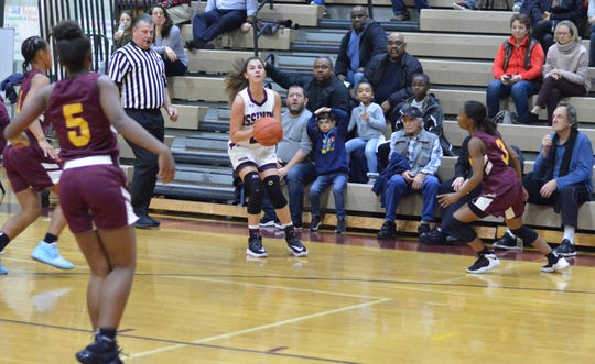 Ossining guard Julia Iorio lines up one of her six 3-pointers in the second half of a decisive win over Mount Vernon on Dec. 3, 2019 at Ossining High School.