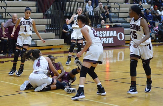 Mount Vernon's Alani Bandoo is surrounded by Ossining and tied up by Brooke Weeks (4) in the first quarter of an 84-44 win by the Pride in the season opener for both teams on Dec. 3, 2019 at Ossining High School.