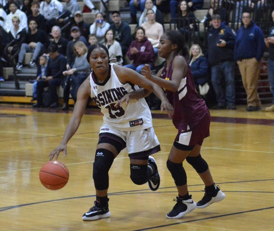 Ossining's Adrianna MacFadden pushes the ball in transition during the third quarter of a season-opening win over Mount Vernon on Dec. 3, 2019 at Ossining High School.