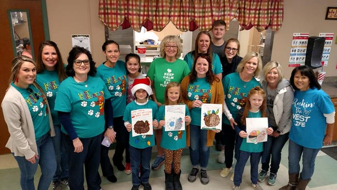 West Foundation Elementary staff and children volunteered to serve meals at the Red Door on Monday, Nov. 25.  Students from West Foundation made turkey art that was handed out to the seniors during lunch. Pictured left to right:  Emily Tackett, Gina Maness, Kim Smith, Liz Atkins, Phoebe Atkins, Adler Atkins, Esme Atkins, Jean McKinney, Shayla Schelter, Melissa Owens, Megan Jones, Trenton Tucker, Karen Gordon, Kambreigh Owen, Shelly Hutchins, Tina Levy