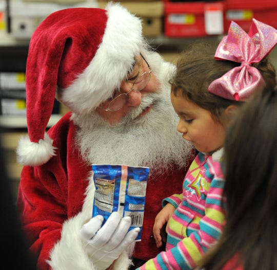 Santa Claus made an early Wednesday morning stop in Wichita Falls for 54th annual Hirschi Realtors and John Hirschi Libra Foundation Christmas Shoe Project held at the Shoe Dept. in Sikes Senter Mall. A total of 40 area Child Cate Inc., and pre-school kids from Head Start received new shoes and socks as well as a visit from Santa himself.