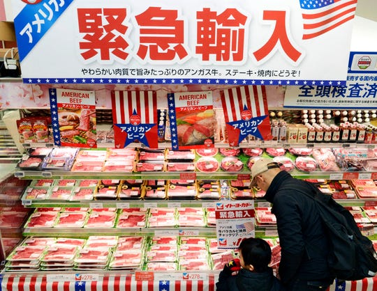 Packages of frozen beef imported from the U.S. are sold at a supermarket in Tokyo. Japan's Parliament has approved a trade deal that was agreed upon by President Donald Trump and Japanese Prime Minister Shinzo Abe earlier this year. The deal cutting tariffs between the countries takes effect at the beginning of next year.