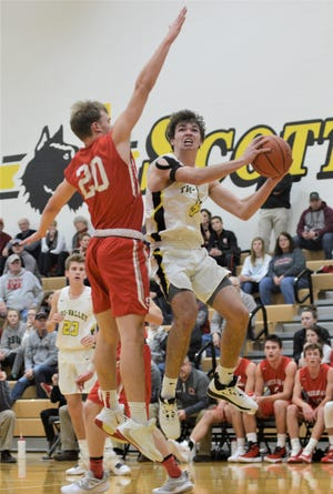 Tri-Valley's Keaton Williams goes up for a shot against Sheridan's Ethan Malone on Tuesday. The Generals won 60-54.