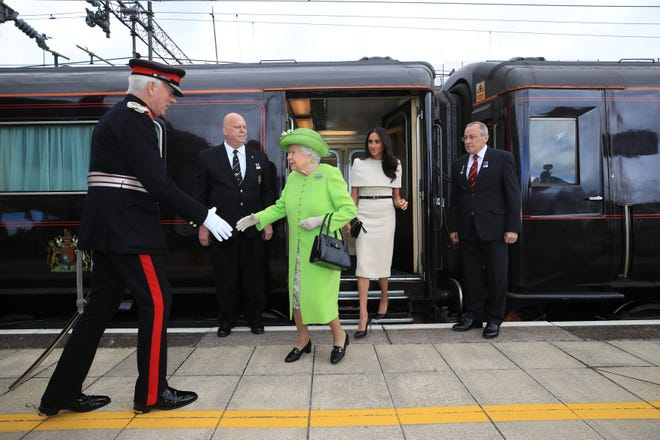 One of the palace travel director's tasks would be arranging travel on the royal train, which Queen Elizabeth and Duchess Meghan took on a visit to Sussex in June 2018.
