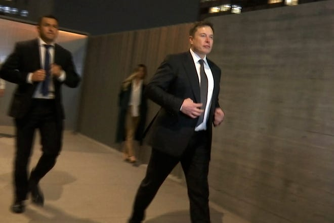 In this frame grab from video, Tesla CEO Elon Musk leaves court, Tuesday, Dec. 3, 2019, in Los Angeles.