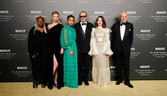 From left, Whoopi Goldberg, Mia Goth, Yara Shahidi, Italian photographer Paolo Roversi, Claire Foy and Pirelli CEO Marco Tronchetti Provera at the 2020 Pirelli Calendar event in Verona, Italy, Tuesday, Dec. 3, 2019.