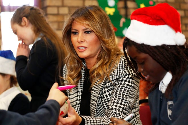 First lady Melania Trump joins local children creating holiday decorations at the Salvation Army Clapton Center in London, Dec. 4, 2019.