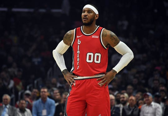 Trail Blazers forward Carmelo Anthony shown during a stoppage in play against the Clippers in the first half at Staples Center.