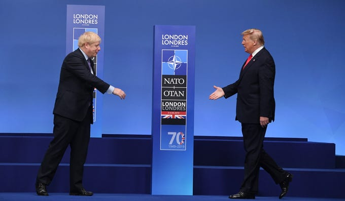 US President Donald Trump greets British Prime Minister Boris Johnson during the NATO Summit in London, Britain on December 4, 2019.