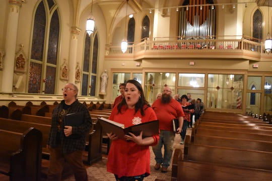 """Members of the Red River Chorale rehearse the processional at St. Francis Xavier Cathedral for their concert, """"Celebrating Christmas,"""" set for 7:30 p.m. Tuesday."""