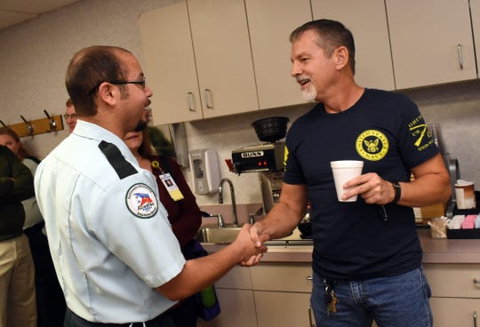 Zachary Metoyer (left), with Acadian Ambulance, greets Richard Rogers, a cyclist who was hit by a truck last year. Rogers was a Rapides Regional Medical Center Thursday to thank everyone who worked on him for saving his life.