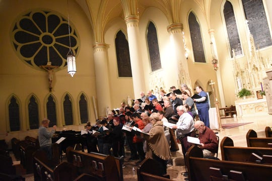 """The Red River Chorale rehearses for their concert, """"Celebrating Christmas"""" at St. Francis Xavier Cathedral. The concert is set for 7:30 p.m. Tuesday."""
