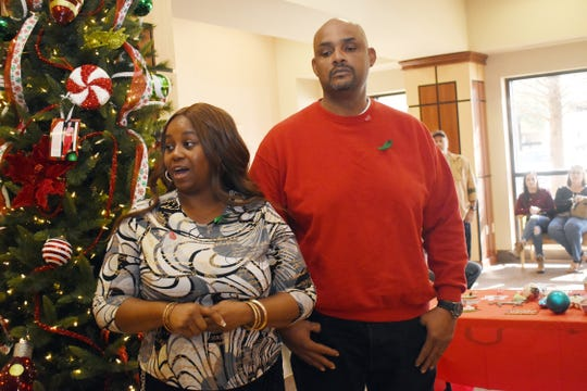Chasity Tassin (left) and Andrew Moran speak about their late daughter, Aliyah Moran, before hanging an ornament in her memory on the Tree of Life at Rapides Regional Medical Center.