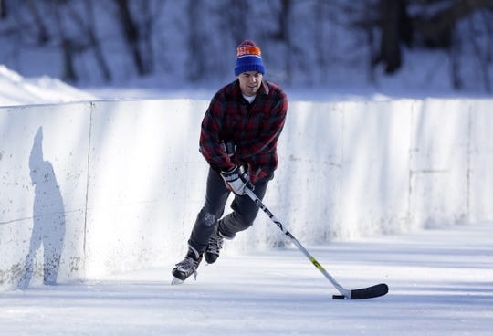 Scott Engstrom of Appleton skates at the ice rink in Jones Park in Appleton on in January 2016. After a few years off, the park will again have skating rinks this winter.