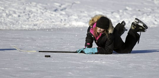 Ally Jansen of Neenah laughs as she slips on the ice at Washington Park in Neenah in 2018.