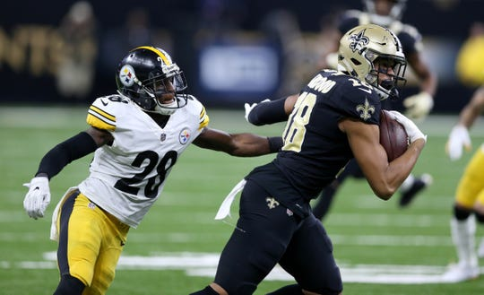 New Orleans Saints wide receiver Keith Kirkwood (18) runs from Pittsburgh Steelers cornerback Mike Hilton (28) after a catch in the second half at the Mercedes-Benz Superdome. The Saints won, 31-28.