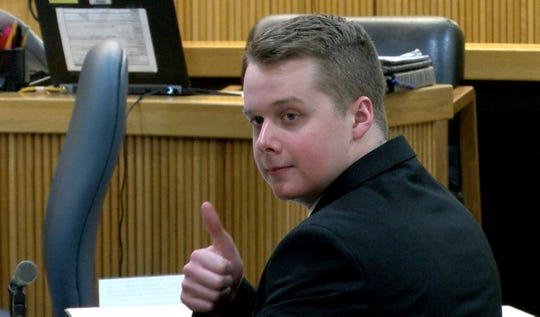 Liam McAtasney turns around to give his family members a thumbs up before the start of the afternoon session of his trial Thursday, January 24, 2019, in State Superior Court in Freehold.  He is charged with the murder of Sarah Stern.