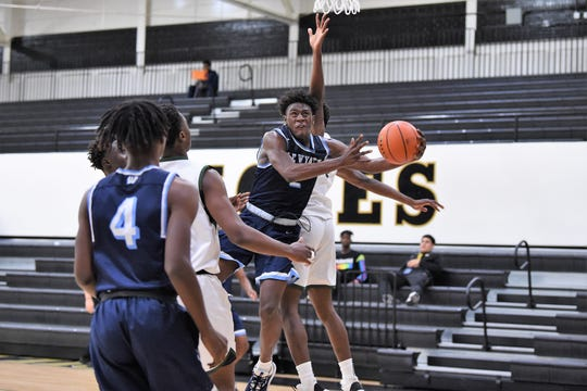 Fort Worth Wyatt's Toney Green, Jr. (2) gets fouled trying to go under a North Central Texas Academy defender during the first round of the Raising Cane's Abilene Key City Classic at Eagle Gym on Thursday. The Chaparrals came into the tournament as the No. 8 in Class 5A.